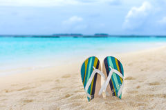 Beach slippers in the sand at Maldives. In front of Indian ocean Stock Photo