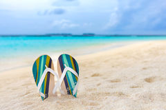 Beach slippers in the sand at Maldives. In front of Indian ocean Royalty Free Stock Image