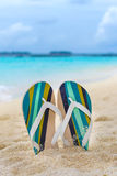 Beach slippers in the sand at Maldives. In front of Indian ocean Royalty Free Stock Images