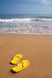 Beach slippers on sandy beach Royalty Free Stock Images