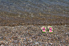 Beach Slippers by the Sea Royalty Free Stock Photos