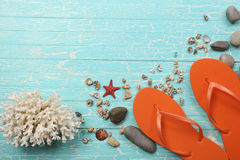 Beach slippers, seashells on the background of  painted boards Royalty Free Stock Images