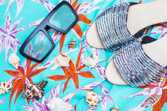 Beach slippers and sunglasses Stock Photography