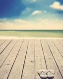 Beach slippers on wood. And sea on background Stock Image