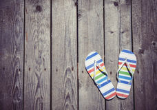 Beach slippers on wood. View form high point Stock Photo