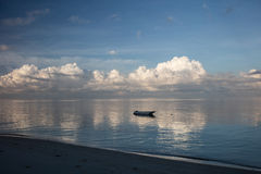 Beach, Small Boat and Calm Water Royalty Free Stock Images