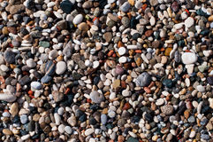 Beach small colored pebble Stock Photography