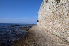 Beach in the small idyllic city Novigrad located on the west coast of Istria peninsula, Croatia.  royalty free stock photography