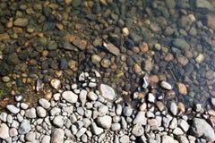 Beach with small stones Stock Photos