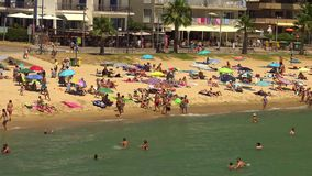 Beach at the small village Sant Antoni de Calonge Costa Brava in Spain in a sunny summer day stock footage