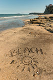 Beach with smiley written in sand Royalty Free Stock Image