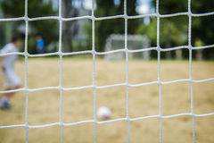 Beach soccer player through the net. Rio olympic games. Royalty Free Stock Images