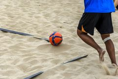 A beach soccer player ready to take a corner Stock Images