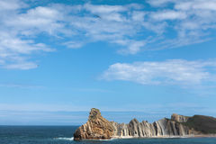 The beach of Somocuevas in Liencres, Cantabria, Spain. The picture represents a landscape of the Cantabrian coast, beach Portio in Liencres. The sea, blue sky Royalty Free Stock Photography