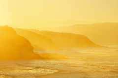 Beach in Sopela at hazy sunset. Beach in Sopela at hazy yellow sunset stock photo