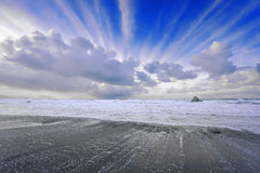 Beach in Sopelana with airplane trails. On sky Stock Photography