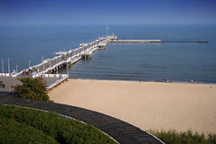 The Beach in Sopot. The wooden pier and beach in Sopot, Pomerania Stock Image