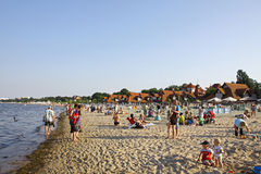 Beach in Sopot, Baltic sea, Poland. SOPOT, POLAND - JULY 26, 2012: Crowded Municipal beach in Sopot, Baltic sea, Poland Royalty Free Stock Image