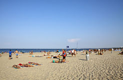 Beach in Sopot, Baltic sea, Poland. SOPOT, POLAND - JULY 26, 2012: People sunbathing at the beach in Sopot city, Baltic sea, Poland Stock Image