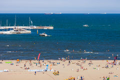 Beach in Sopot. Sandy beach scene of many people suntanning, relaxing and enjoying the shore in summer day on August 9, 2015 in Sopot, Poland Royalty Free Stock Photos