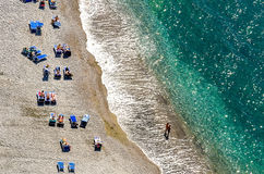 Beach in Sorrento Coast, Italy. Beach in Sorrento Coast, bathers abronzano the sun, Italy Stock Photo