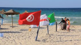 Beach in Sousse, Tunisia. TUNISIA, SOUSSE, JULY 3, 2010: Tunisian flags and tunisian people on the beach in Sousse, Tunisia, July 3, 2010 stock footage