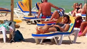 Beach in Sousse, Tunisia. TUNISIA, SOUSSE, JULY 9, 2010: Tunisian people bath and sunbathe on the beach in Sousse, Tunisia, July 9, 2010 stock footage