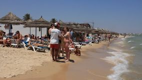 Beach in Sousse, Tunisia. People bath and sunbathe on the beach stock footage