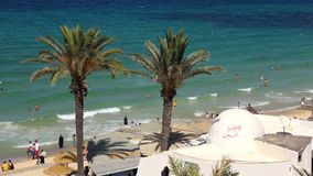 Beach in Sousse, Tunisia. People bathing and sunbathing on the beach stock video footage