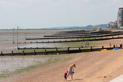 Beach in Southend on sea in summer day. Southend on sea, UK - June 18, 2017: Beach in summer sunny day during tide out Royalty Free Stock Images