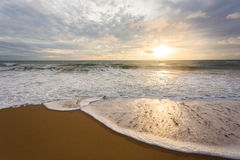 Beach. Space on a beach. Seascape in sunrise and white wave stock images