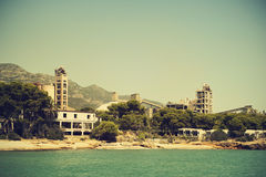 Beach in Spain and factory. Beach with factory behind In Spain during summertime Stock Image