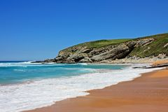 Beach located in Suances, Spain. Perfect beach with clear sand located in Suances, Spain royalty free stock image