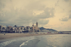 Beach in the Spanish seaside resort Sitges; retro Instagram style Stock Images