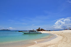 Beach with speedboat Stock Photos