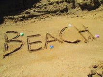 Beach spelled in a sand Stock Photos