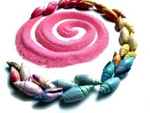 Beach spiral. An spiral with pink sand and colored snails Royalty Free Stock Image