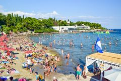 The beach of Split. Split, Croatia - July 10, 2018: Tourists on the city beach royalty free stock image