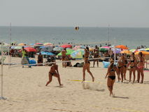 Beach sport. Summer vacation people playing volleyball on the beach Stock Photo