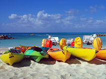 Beach sports equipment. Colorful water sports equipment on a sandy beach Royalty Free Stock Photos