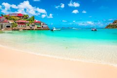 Beach in St Barts, Caribbean Sea. Bright and colorful image of Nikki beach near St Jean Beach in Saint Barthelemy, St Barths, St Barts royalty free stock photography