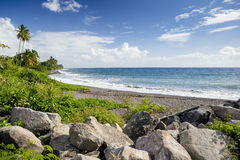 Beach on a St. Kitts island with black sand Stock Photos