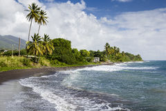 Beach on a St. Kitts island with black sand Royalty Free Stock Photo