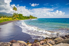 Beach on a St. Kitts island with black sand Stock Images