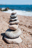 Beach with stacked stones Royalty Free Stock Photography