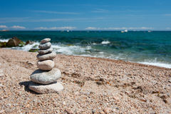 Beach with stacked stones Stock Photography