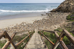 Beach Stairs at Dume Cove in Malibu California. Rusty beach stairs at Dume Cove in Malibu, California Royalty Free Stock Photography