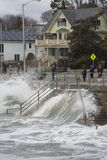 Beach Stairway Under Water. Onlookers of the ocean storm viewing the large waves over the stairway stock image