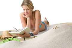 Beach - Starfish on sand, woman with book Stock Images
