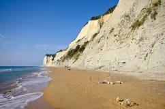 Beach and steep cliffs near Agios Stefanos, Corfu island, Greece Royalty Free Stock Photo